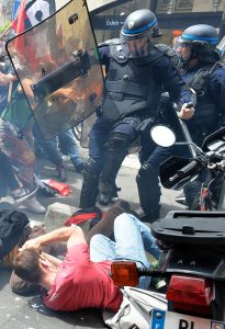 """Security forces clash with demonstrators during a protest called by seven labour unions and students against the labour and employment law reform on May 26, 2016 in Bordeaux, southwest France. Fresh rallies were due to be held May 26 in Paris and other cities in the latest bout of social unrest that started three months ago and has frequently turned violent. Under intense pressure, Prime Minister Manuel Valls vowed the labour law would not be withdrawn, but said it might still be possible to make """"changes"""" or """"improvements"""". / AFP PHOTO / GEORGES GOBETGEORGES GOBET/AFP/Getty Images"""